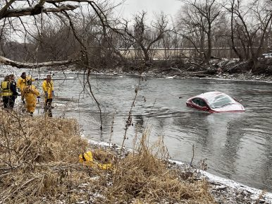 No one was inside this maroon Ford sedan, which was found half submerged in the Des Plaines River on the morning of Jan. 24. | Photo by Bob Uphues/Editor