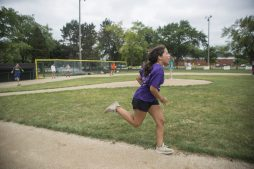 Kids participating in the summer camp program play together on Aug. 3, during a game of kickball at Kiwanis Park in Brookfield. (Alex Rogals/Staff Photographer)