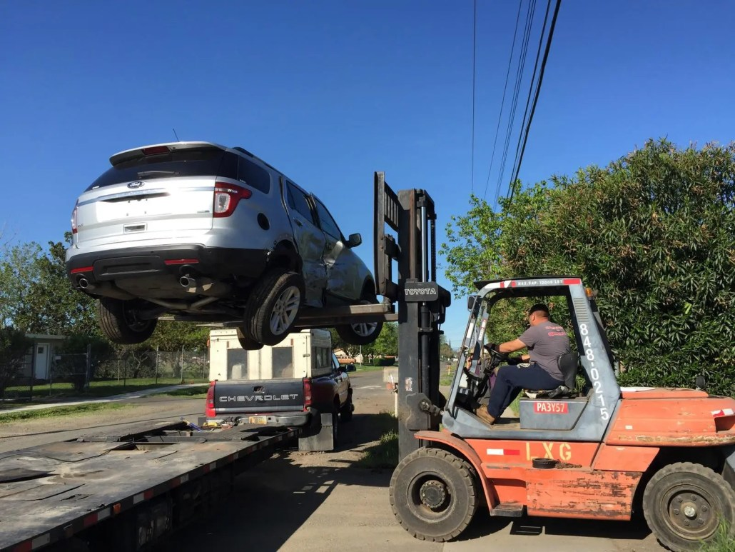 Non Running Car Being Unloaded