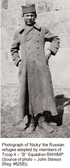 """Photograph of Nicky the refugee who was adopted by Troop 4 members - """"B"""" Squadron RNWMP"""