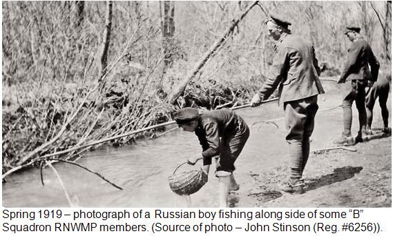 "Photograph of ""B"" Squadron RNWMP members fishing in creek near Second River Barracks"