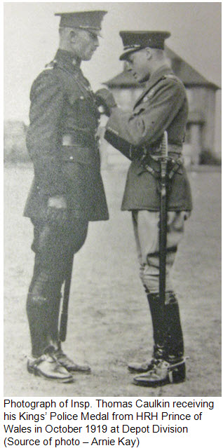 Photograph of Thomas Caulkin receiving Kings' Police Medal from Prince of Wales