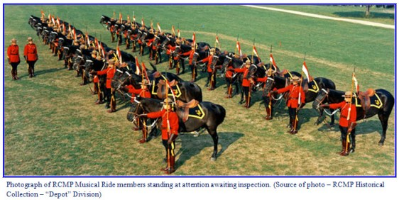 Photograph of RCMP Musical Ride members standing by their horse