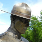 Photograph of bronze statue of RCMP member wearing a stetson