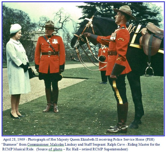 Photograph of Queen Elizabeth receiving Burmese from the RCMP