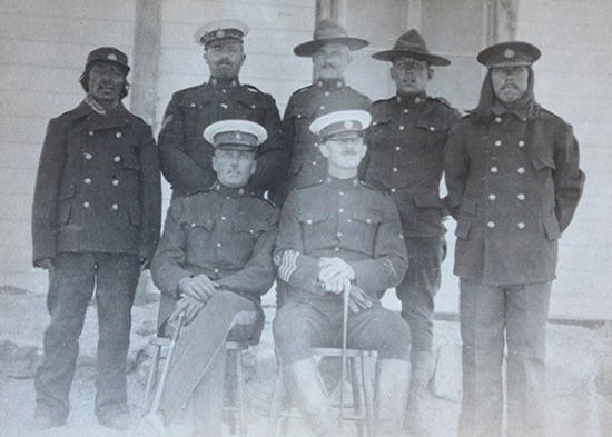 July 1916 - Photograph of  Akular, Cpl. Conway, Cst. Kennedy, Cst. Pasley and Joe. Insp. Beyts and S/M Caulkin taken at Baker Lake. (Source of photo - Library Archives of Canada).