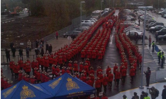 Photograph of RCMP Constable Adrian Oliver's casket departing the Langley Sports Centre