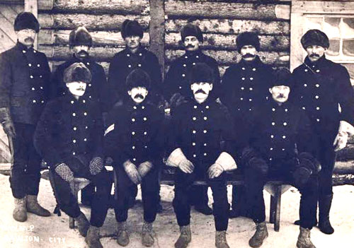 """Photograph of Northwest Mounted Police (NMWP) members wearing the uniform similar to what was worn by Constable William Ross (Source of photo - RCMP Historical Collections Unit - """"Depot"""" Division)"""