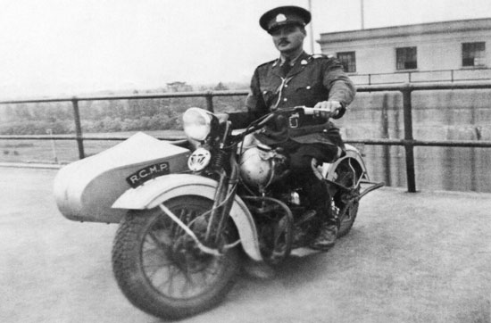 Photograph of an early RCMP Motorcycle (Source of photo - Ric Hall's Photo Collection)