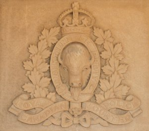 "Photograph of the RNWMP King Crown crest inside the ""Depot"" Division's Drill Hall in Regina (Source of photo - Sheldon Boles)"
