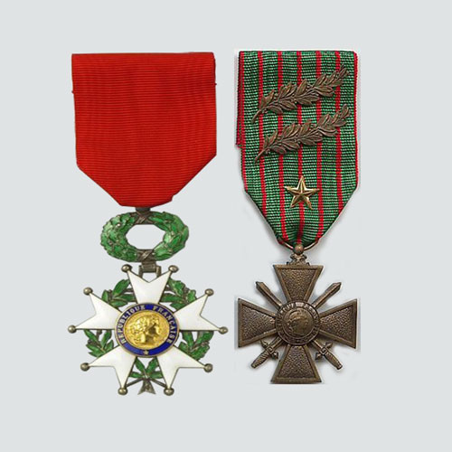 Photograph of the French Legion Of Honour and the Croix de Guerve medals.