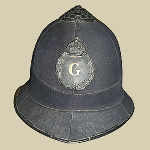 Photograph of an old helmet for the Gloucester Constabulary.
