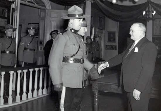 April 1946 Charlottetown PEI - Constable William Warner is receiving the King's Police Medal from Lt. Gov. J. Bernard (Source of photo - Ric Hall's Photo Collection)