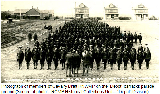 "May 1918 - Photograph of Cavalry Draft RNWMP members on the parade square in front of both ""A"" and ""B"" Blocks (Source of photo - RCMP Historical Collections Unit - ""Depot"" Division)."