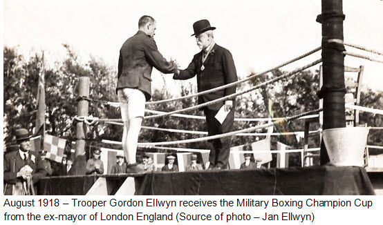 August 1918 - Photograph of Cavalry Draft RNWMP trooper Gordon Ellwyn receiving the winning boxing championship cup from the ex-mayor of London England (Source of photo - the Ellwyn family).