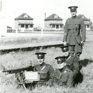 "1914 - 1919 - Photograph of RNWMP Depot firearms training. Note the officer's houses in the background (Source of the photo - RCMP Historical Collections Unit - ""Depot"" Division)."