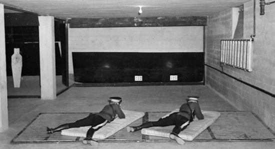 1930s - Photograph of the indoors rifle range in the basement under the gym at Depot Division (Source of photo - Ric Hall's Photo Collection).