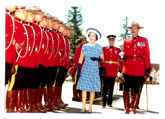 "1973 Photograph of Queen Elizabeth II inspecting RCMP Recruits at ""Depot"" Division.  The Queen is escorted by Supt. Bill MacRae followed by Commissioner WIlliam Higgitt (Source of photo - RCMP Historical Collections Unit - ""Depot"" Division)."