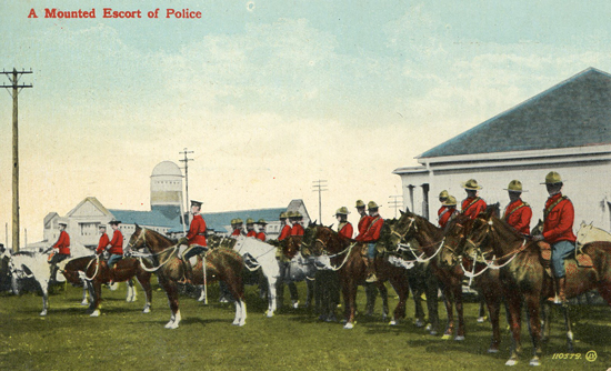 Post card of a mounted police escort. (Source of photo - Ric Hall's Photo Collection).