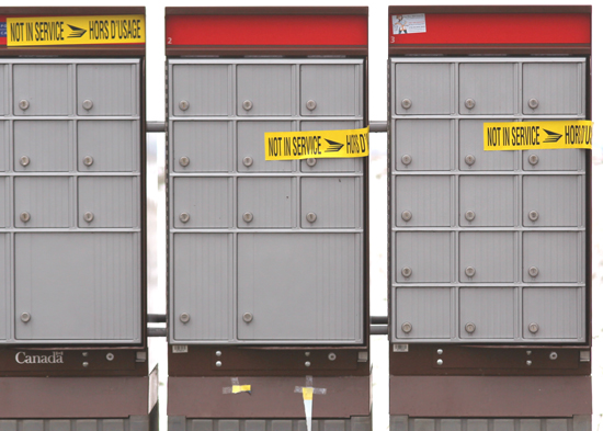Photograph of Canada Posts' Super Mail Boxes that have  been tagged as being compromised (Source of photo - Sheldon Boles).