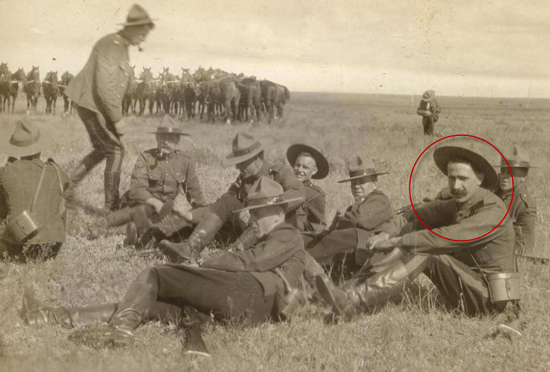 Photograph of RNWMP members resting while on patrol. Frank Pearson is identified with a red circle (Source of photo - Ric Hall's Photo Collection).