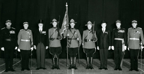 1957 - After the presentation - Hon. (Major-General) George Pearkes VC, PC, CC, CB, DSO, MC, CD., Minister of National Defence with the Force Guidon and members of the Force. (Source of photo - Ric Hall's Photo Collection).