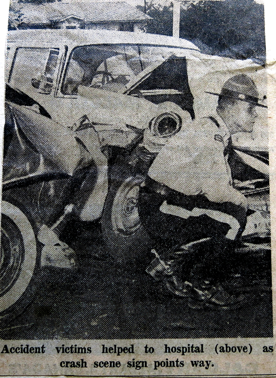 August 1962 - Photograph of an RCMP member surveying the damage from a motor vehicle accident in Surrey BC. (Source of photo - Barry Bradley's Newspaper clipping collection)
