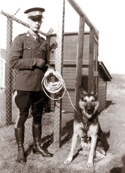 1938 - Photograph of Police Service Dog - Dale with Sub-Constable Lorne C. Cawsey (son of Sgt. John Cawsey) taken in Madstone Saskatchewan (Source of photo - Ric Hall's Photo Collection).
