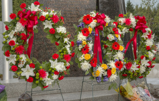 """June 10, 2014 - Photograph of the three wreaths laid at the base of the """"E"""" Division RCMP Memorial in honour for the three Moncton RCMP members killed on duty (Source of photo - Sheldon Boles)"""