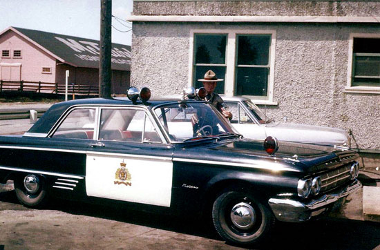 1962-63: Photograph of an unknown RCMP members taken outside the Pattullo Bridge Detachment (Surrey, BC) (Source of photo – Ric Hall's Photo Collection)