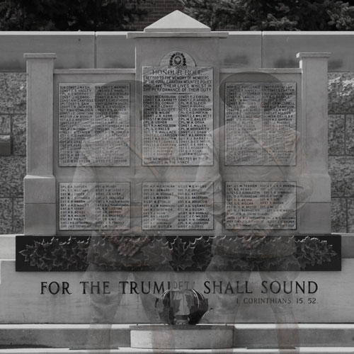 Photograph of the RCMP Cenotaph with the ghost images of two RCMP members bowing their heads (Source of image - Sheldon Boles).