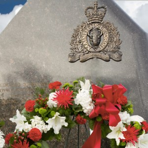 """June 10, 2014 - Photograph of the flowers laid at the """"E"""" Division Memorial for the three Moncton RCMP members killed on duty (Source of photo - Sheldon Boles)"""