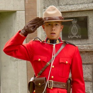Photograph of Constable Arron Cheny of Burnaby RCMP Detachment saluting at the RCMP memorial (source of photo - Sheldon Boles)