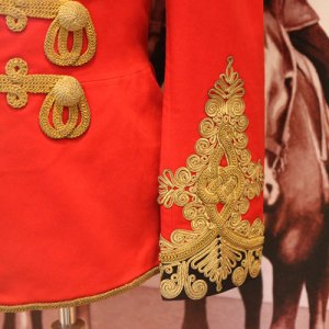 Photograph of NWMP officer's red serge with Austrian knot (Source of photo - Sheldon Boles).