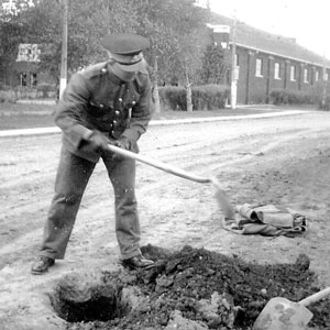 Photograph of a RCMP Recruit doing extra duties (Source of photo - Vancouver Division - RCMP Veterans' Association)