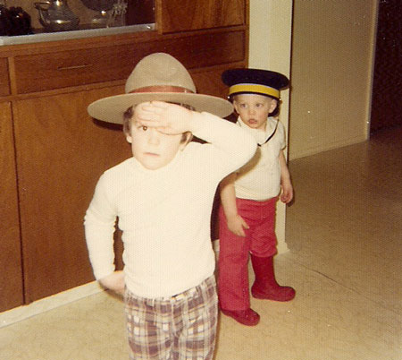 Photograph of two member's children wearing the different hats of their father (Source of photo - Ric Hall's Photo Collection).
