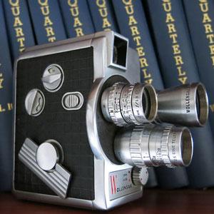Photograph of movie camera and RCMP Quarterlies (Source of photo - Sheldon Boles).