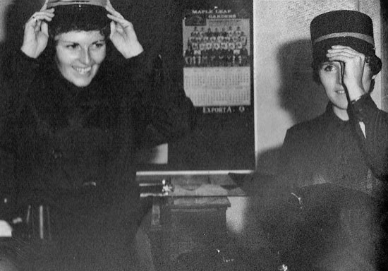 Photograph of RCMP #17 Troop members: Cheryl Joyce and Jan Graham trying on their new female member hats (Source of photo - Ric Hall's Photo Collection)..