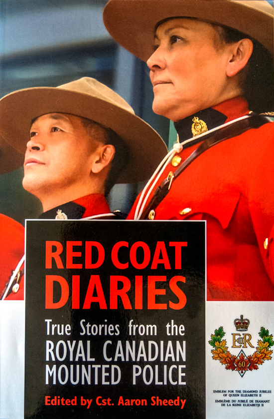 """Photograph of the book cover for the book """"Red Coat Diaries: True Stories From The Royal  Canadian Mounted Police"""" Edited by Cst. Aaron Sheedy."""