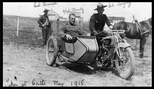 1915 - Photograph of RNWMP members trying out their new motorcycle (Source of photo - Ric Hall's Photo Collection).