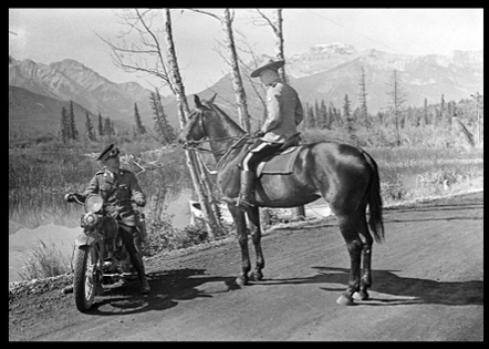 Photograph of a horse mounted RCMP member and another member on a motorcycle (Source of photo - Ric Hall's Photo Collection).