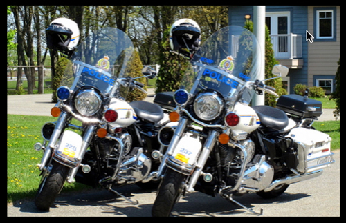 """Photograph - """"On Parade or On Patrol a couple of beauties!"""" -  RCMP Motorcycles (Source of photo - Ric Hall's Photo Collection)."""