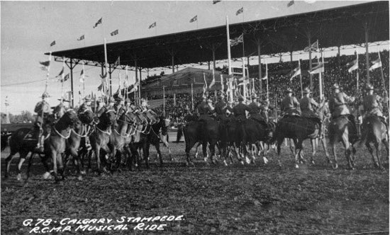 """1935 Calgary Stampede with the RCMP members from """"Depot"""" Division performing the Musical Ride."""" (Source of photo - University of Calgary)."""