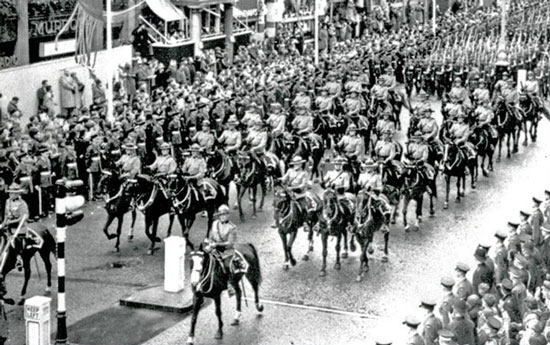 """1953 - Queen Elizabeth II's Coronation ini London England with the RCMP Musical Ride (Source of photo - RCMP Historical Collections Unit - """"Depot"""" Division)."""