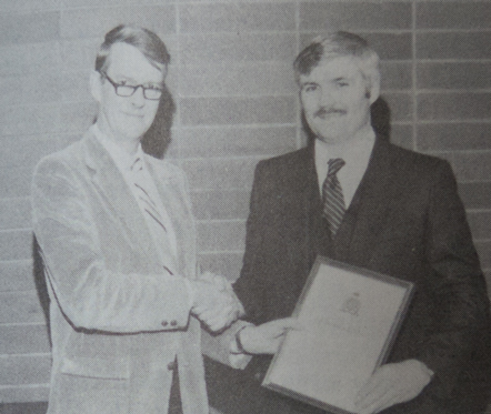 Supt. George Strathdee presents RCMP Corporal Dalton Watson with the Commanding Officer's Commendation (Source of photo - RCMP Quarterly - Volume 49, No. 3 - page67)