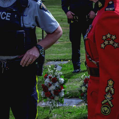 Photograph of two RCMP members standing at the memorial (Source of photo - Sheldon Boles).