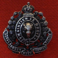 "Photograph of a RNWMP collar badge with the ""Royal"" added (Source of photo - Sheldon Boles)."