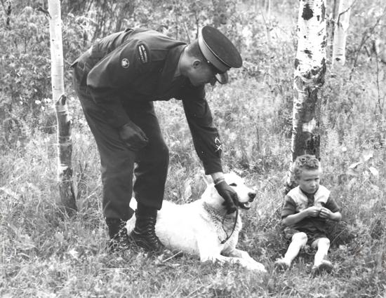 Photograph of Constable John Stolarski with his police service dog Caesar (Source of photo - Mildred Stolarski).