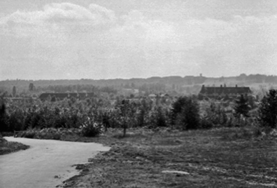1935 - Photograph of Fairmont Barracks in the distance.  It is located in a very rustic area of Vancouver.  Note the four stables on off to the left (Source of photo - Ric Hall's Photo Collection).