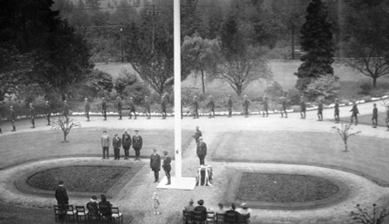 Photograph of RCMP members marking into the ceremony (Source of photo - Ric Hall's Photo Collection).